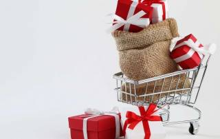 christmas shopping parcels in shopping basket