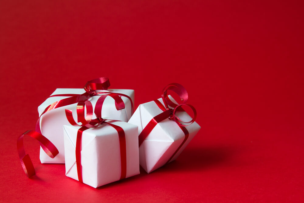 Christmas gift boxes with red ribbon